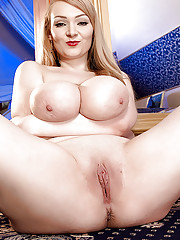 Euro blonde with big saggy tits Micky Bells spreads legs revealing a pink cave