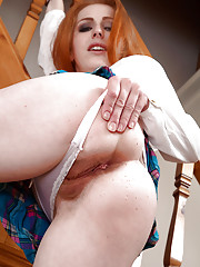 Euro mommy Tia Jones unveiling hairy ginger pussy in over the knee socks