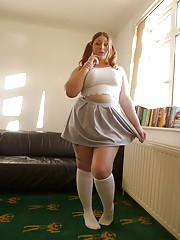Fat amateur Estella Bathory showing off big ass in white socks and pigtails