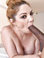 Naked mom Kiki Daire giving her black masseur with the large dick oral sex