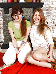 Lesbians Anni Bay and Loredana undress for licking of hairy pussies
