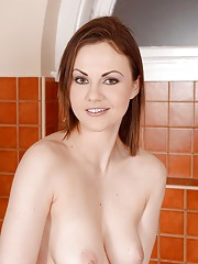Hot babe with big natural breasts Tina Kay plays with her pink cave in a bath