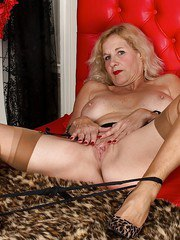 European mature chick with a plump body takes off panties and spreads legs