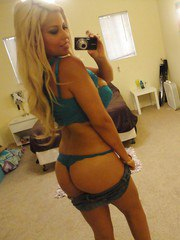 Sultry Latina chick Bridgette B stripping during self shots in mirror