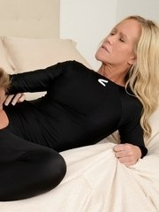 MILF with shaved pussy enjoys clothed sex and rides a cock like a real pro
