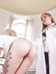 Kinky female doctor having her way with tattooed blonde submissive