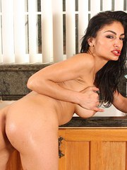 Charming MILF with black hair Persia Pele washes shaved twat in the kitchen
