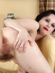Older dark haired lady Nikita airing out her hairy bush with panty removal