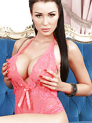 Busty European model Patty Michova reveals her round fake boobs and toys pussy