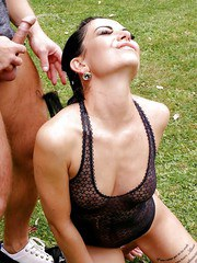 Kinky brunette and her guy friend takes turns pissing on each other in woods