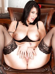 Aged brunette Raven parting her labia lips wearing black stockings