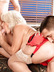 Busty blonde granny Georgette Parks riding 1 stud and blowing another