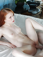 Redhead spinner Dolly Little engaging in hardcore sex acts on bed