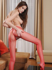 Skinny chick Silvie tugging on hanging labia lips in crotchless pantyhose