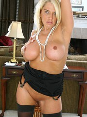 Mature blonde Nicky Masters strips off to boast of her big boobs and pussy