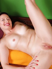 Nice mature woman Kali Karinena undresses and stretches her tight pink holes
