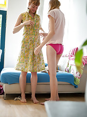 Nude amateurs Laney and Lucy help each with getting dressed after lesbian sex