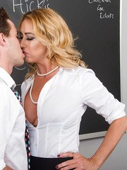 Mature blonde teacher Janna Hicks seducing male student for sex on her desk