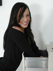 Dark haired MILF Kylee King stripping for nude posing in home office