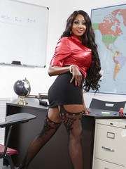 Black schoolteacher Diamond Jackson removing skirt to pose in sexy stockings
