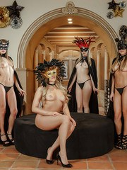 Topless blonde lesbians remove black thongs and masks to pose nude together