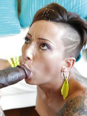 Tattooed female Bella Bellz riding a BBC before sucking the jizz out of it
