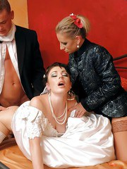 Clothed Euro women pee on each other in kinky wedding night threesome