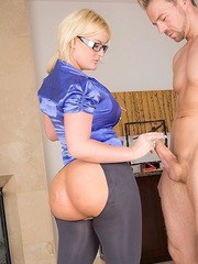 Blonde chick with big butt Julie Cash sucking cock on knees wearing glasses