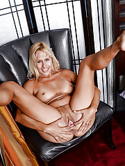 Mature blonde Payton Leigh shows big natural boobs and stretches hairy pussy