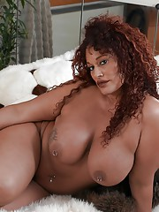 Fat black woman Gina P unleashing her big boobs while undressing to masturbate