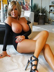 Mature housewife Sandra Otterson showing off knockers and great legs