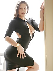 Hot pornstar in a sexy dress Abella Danger slowly strips playing erotic solo