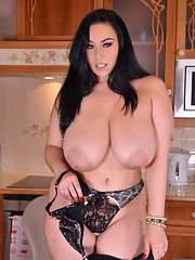 Thick brunette Anastasia Lux uncorking her massive all natural tits in kitchen