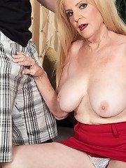 Horny busty granny Charlie opens her hairy pussy and begs for a hard cock