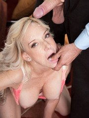 Hot mature blonde Mirabella Amore showing off her latest mouthful of semen