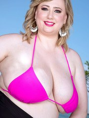 Overweight solo model Laddie Lynn strips off bikini top and shorts in pool