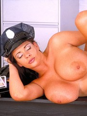 British policewoman Linsey Dawn McKenzie baring hooters and beaver at work