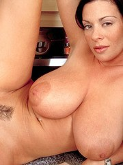 Housewife Linsey Dawn McKenzie baring hooters and muff on kitchen counter