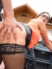 Clothed female in leather mini and glasses fucks right in the driveway