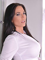 Sexy Euro MILF Simony Diamond slides shorts over ass with legs crossed in air