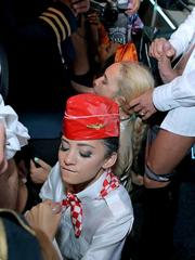 Drunk pornstars and stewardesses join pilots for group sex fuck fest