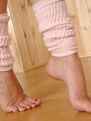 Euro beauty Nicole Smith modeling sexy feet in pink leg warmers and spandex