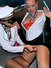 Horny stewardesses fuck each other and pilots during an after work orgy