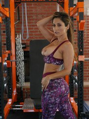 Hot MILF Reena Sky peels away spandex clothing to bare her enticing nude body