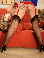 Hot blonde wife Andrea looks irresistible in sexy lingerie and hosiery