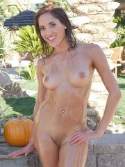 Naked Latina Chloe Amour is completely soaked in oil before sucking a cock