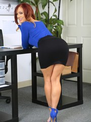 MILF with big round boobs Dani Jensen undresses to play a solo in the office