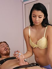 Raven haired masseuse Nikki Vixen binds man to massage table before a handjob