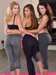 3 girls in yoga pants and sports bras strip each other naked