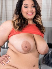 Gorgeous Latina fatty Chevy Cobain plays with huge tits and rubs meaty pussy